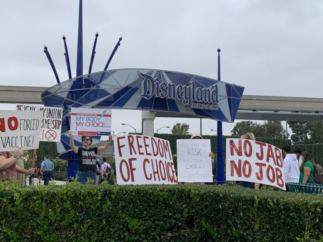 Californians protest against the vaccine mandate in front of Disneyland