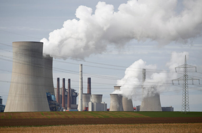 Steam rises from the five brown coal-fired power units of RWE, one of Europe's biggest electricity companies in Neurath, n...